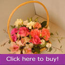 Mixed flower arrangement in a basket